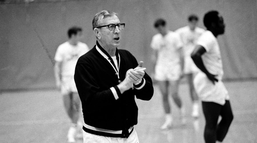 UCLA basketball coach John Wooden claps his hands and shouts encouragement to members of his Bruin team during a practice session in Los Angeles, Ca., March 7, 1967.  (AP Photo)