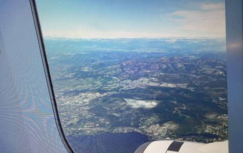 A screenshot from Microsoft Simulator, the side view from an A320 Neo flying out of Nice, France