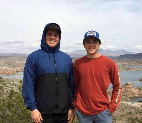 Senior Jackson Swain (left) works two jobs to save up for college, but he still finds time for friends, like senior Miles Hatch (right), when he can.